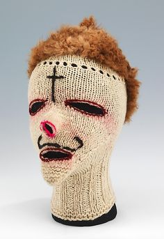 Ski mask  Pinata Party, Inc.     Date:      ca. 1960  Culture:      Peruvian  Medium:      wool, fur  Dimensions:      11 x 13 1/2 in. (27.9 x 34.3 cm)  Credit Line:      Brooklyn Museum Costume Collection at The Metropolitan Museum of Art, Gift of the Brooklyn Museum, 2009; Gift of Clare E. Walker, 1967