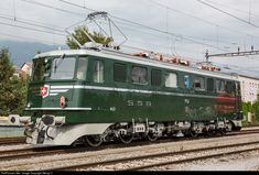 """Former Gotthard locomotive Ae 6/6 # 11407 with name and blazon of canton """"Aargau"""", with around 6000 Hp, built in 1956 by SLM, BBC and MFO for the SBB and now running for association Mikado 1244 (on long term loan from SBB Historic), ready for departure in Biel freight yard, back to her home depot Brugg (AG) after the exhibition in Geneva the weekend before."""