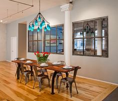 Contemporary dining room by threshold interiors.  Love the interior windows in this loft space.