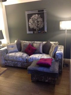 Crushed velvet sofa. Love it! Pink accent cushions with silver and light purple ones to match. Sofa from Sofa works, cushions from next.