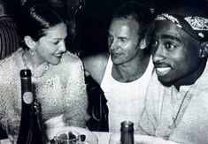 Madonna, Sting and 2Pac.  Definitely not a threesome that I would imagine hanging out, but definitely a cool picture.