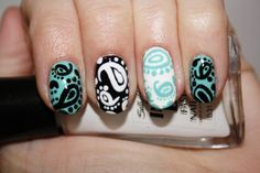 http://polishyoupretty.com/2012/01/25/nail-art-tutorial-paisley-perfection/