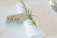 I love the sprigs of rosemary tied to napkins, with hand-calligraphied name tags attached.