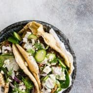 Greek chicken meatball gyros are packed full of fresh herbs and feta cheese, topped with creamy tzatziki sauce and crunchy vegetables. They are a fun twist to traditional gyros and chicken souvlaki. Tzatziki Sauce, Sandwich Wrap, Homemade Crunchwrap Supreme, Carnivore, Chicken Meatballs, Cooking Recipes, Healthy Recipes, Le Diner, Gastronomia