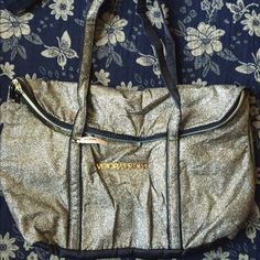 Victoria's Secret Bag Gold sparkly bag in new condition. Questions please ask. trades, thanks  Victoria's Secret Bags