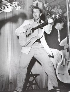 """The photograph was taken by a local photographer named William V. """"Red"""" Robertson during the second performance of the Elvis Presley concert at Fort Homer Hesterly Armory in Tampa, Florida on July 31, 1955. This photo was used for Elvis debut album """"Elvis Presley."""""""