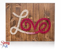 DIY String Art Kit - Love Sign on a stained wood board. Supplies includes HAND sanded and HAND stained pine wood board, highest quality embroidery floss, metallic wire nails, easy to follow instructions, and a pattern template. Visit www.StringoftheArt.com to learn more about this awesome DIY Love Sign String Art Kit.