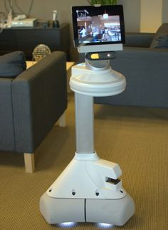 A prototype of Ava, iRobot's mobile robot, takes in her surroundings.