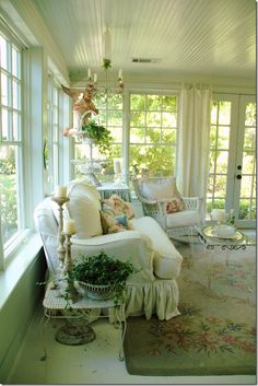 sunporch off living room. paint beadboard ceiling white. white slipcovers. romantic getaway room.
