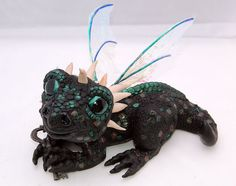 Ooak (one of a kind) Baby Black Dragon.  Now available in my Etsy shop.
