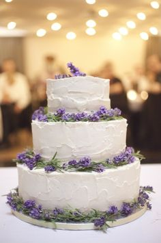 white wedding cake and lavender accent