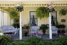 This is why I'd like to remove the railing from the front porch - more inviting without. Makes me smile...love this!