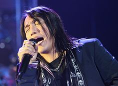Arnel Pineda, lead singer of the rock band Journey | Not strictly Filipino-American but rather a Philippine National while at the same time a famous American rock star