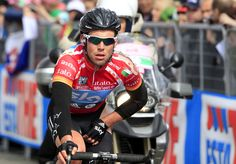 British world champion (with red jersey) Mark Cavendish crosses the finish line at the third stage of Tour of Italy cycling race on May 7, 2012 in Horsens. AFP PHOTO /LUK BENIESLUK BENIES/AFP/GettyImages