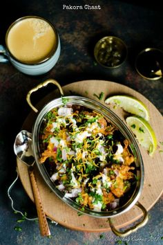 Pakora Chaat  This Pakoda chaat is a quick tea time snack with onion pakoras / onion fritters as the base and an assortment of chutneys and other accompaniments on top!  Indian Food, Indian Street Food, Indian Snack