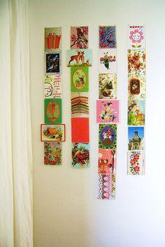 wall of postcards, via Flickr.