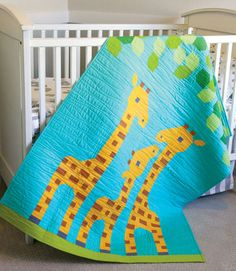 Leafy greens are for lunch on this utterly adorable crib quilt.