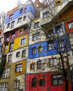 """Hundertwasser House, Vienna, Austria. """"The house was built between 1983 and 1986. It features undulating floors, a roof covered with earth and grass, and large trees growing from inside the rooms, with limbs extending from windows."""" text & photo by MarcelGermain. via flickr"""