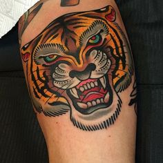 Big and bold tiger head tattoo by Samuele Briganti (IG—samuelebriganti). #bigcats #bold #busts #colorful #fierce #SamueleBriganti #tiger #traditional