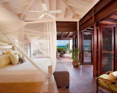 Because this villa is on a private Island, the louvered doors can be left open for a truly indoor/outdoor bedroom.