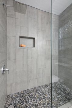 Walk In Shower With Chrome Fixtures And Flat River Rock Floor