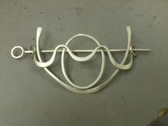 This is one of my pieces.  It is a hairpin.