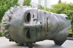 A creepy sculpture of a decapitated head invites viewers to see St. Louis through its empty eyes.