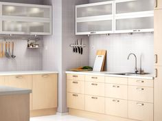 Drawers only on bottom FAKTUM kitchen with NEXUS birch veneer doors/drawers and VÄRDE white glass-door cabinets