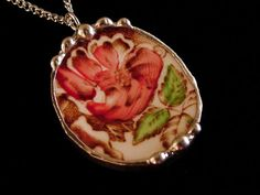 Artist on etsy is making jewelry from broken china, probably using stained glass foil/solder method.