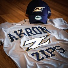 Show everyone you root for the Zips with this Akron Zips Mens Grey Short Sleeve T Shirt! Rally House has a great selection of new and exclusive Akron Zips t-shirts, hats, gifts and apparel, in-store and online. Akron Zips, T Shirt Image, Team Names, Short Sleeve Tee, Sweatshirts, Grey, Sweaters, Tops, Fashion