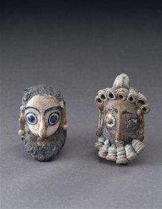 Two Glass Head Pendant. Origin: Carthage Dating: III century B.C.