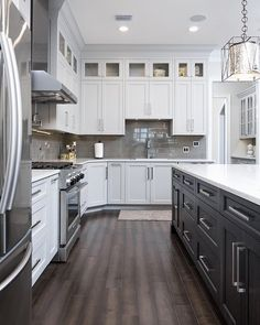 White Shaker Kitchen Cabinets with dark kitchen island and stainless steel appliances White Shaker Cabinets, White Kitchen Cabinets, Kitchen Shelves, Kitchen Island, Shaker Doors, Shaker Style Cabinets, Dark Kitchen Floors, Upper Cabinets, Oak Cabinets