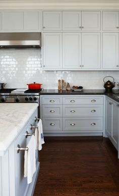 The kitchen cabinets were painted with Benjamin's Moore's Gentle Gray (with the color lightened, by 50 percent, on the upper cabinets).