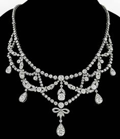 Edwardian French Diamond Platinum Necklace. This elegant platinum necklace is set with sparkling old mine cut diamonds weighing approximately 18.00 carat and is graded F-G color with VS clarity. The necklace is stamped with original French hallmarks. c1910