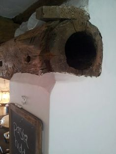 Old drainpipe in kitchen inglenook.
