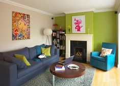 Eclectic living room with green wallpaper [Design: Think Contemporary]