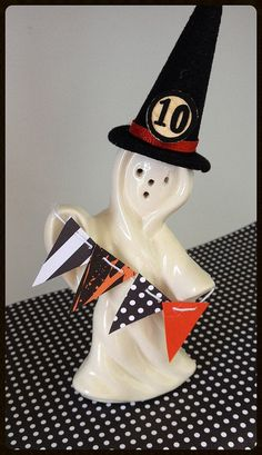 Halloween Decoration A vintage ghost is all dressed up for Halloween. He is wearing a velvet witches hat with an orange ribbon and a bingo…
