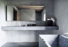 I love the sink but it's too much cement over all and needs a mix of glass and wood to compliment