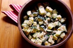 Marinated Cucumbers with Feta. Made with cucumbers, feta, red wine vinegar, olive oil, crushed red pepper, dried oregano, dried dill weed, and pepper.