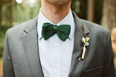 groom in preppy emerald bow tie and gray suit.