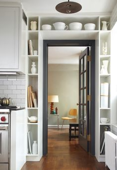 Arresting Maximizing Space In A Small Apartment in Kitchen Industrial design ideas with Arresting chopping boards collection glass door gray casing light gray walls niches pendant