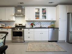 Property Brothers: White subway backsplash and white kitchen cabinets.