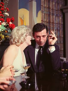 Marilyn Monroe and Yves Montand at a press conference for Let's Make Love, 1960.