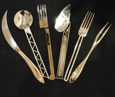 A selection of modern flatware, from left to right, Arpège vegetable knife, Christofle 2005, designed by Alain Passard, chef and owner of L'Arpège Restaurant., Trussware dinner spoon, designed 1903, executed in sterling silver by Boris Bally, 2001, XUM dinner fork, designed by Robert Wilhite, 1990,Table Tools table knife, designed and handmade in sterling silver by Boris Bally, 2001, Arpège vegetable fork.