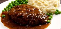 Salisbury Steak + brown onion gravy: gd beef 1 egg 1 T tomato paste 1 T yellow mustard 2 T Worcestershire sauce ½ tsp garlic powder ¼ c dry breadcrumbs ½ tsp black pepper kosher salt Homemade Salisbury Steak, Salisbury Steak Recipes, Delicious Gravy Recipe, Delicious Recipes, Sauce Steak, Tiphero Recipes, Onion Gravy, The Heat, Creamy Mashed Potatoes