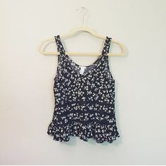 Floral & lace swing tank Super cute floral swing tank with black lace stripes from Forever 21 (not brand listed) a bit cropped. Perfect for festivals  size medium but also fits a size small. Excellent condition!    • make an offer! ^_^ • Free People Tops Tank Tops
