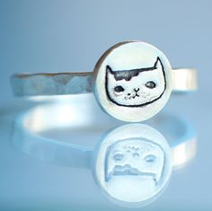 Martha the CAT stacking ring, illustration by GEMMA CORRELL, eco friendly silver. Handcrafted by Chocolate and Steel. $44.00, via Etsy.