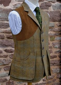 A dark tweed with a light blue and dark brown showing well, this is a shooting waistcoat for wearing under a coat or over a shirt on its own as seen here for the warmer early season days. The tie is typical of what is often worn to driven days.