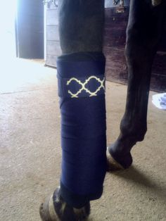 "Equine Standing Wraps/Navy Blue Standing Wraps w/Decorative Velcro Straps.  Made of Navy stretch polyester that is comparable to the stable bandages from Dover Saddlery. Made with industrial strength Velcro to ensure a strong hold.  Sold in Set of 4 Wraps. Two sizes offered: Pony: 2 yards (6ft) long, 5"" wide or Horse: 4 Yards (12 ft) long, 5"" wide"