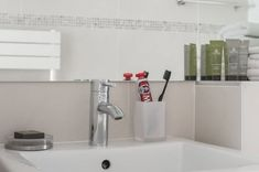 Marais designer 1BR, close to everything, up to 4 guest - Saint-Gervais Paris Airbnb, King Bedroom, Exterior Lighting, Walk In Shower, Washer And Dryer, Kitchen Utensils, Second Floor, Dining Area, Basin